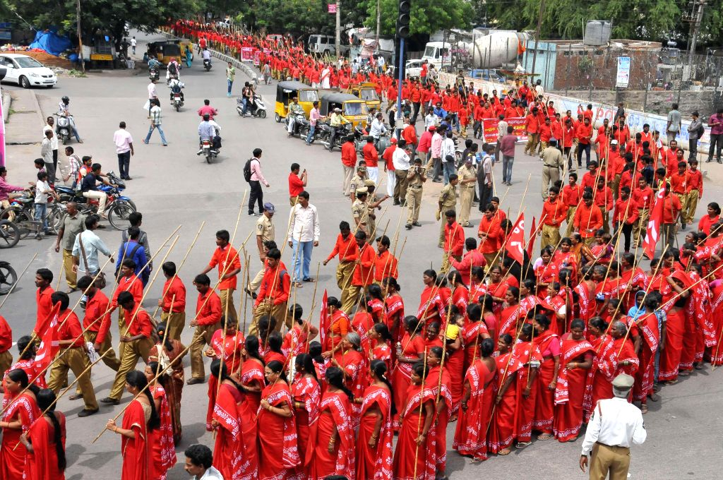 CPI (M) workers participate in a rally organised to celebrate centenary of party leader Chandra Rajeswara Rao in Hyderabad on Aug 11, 2014.