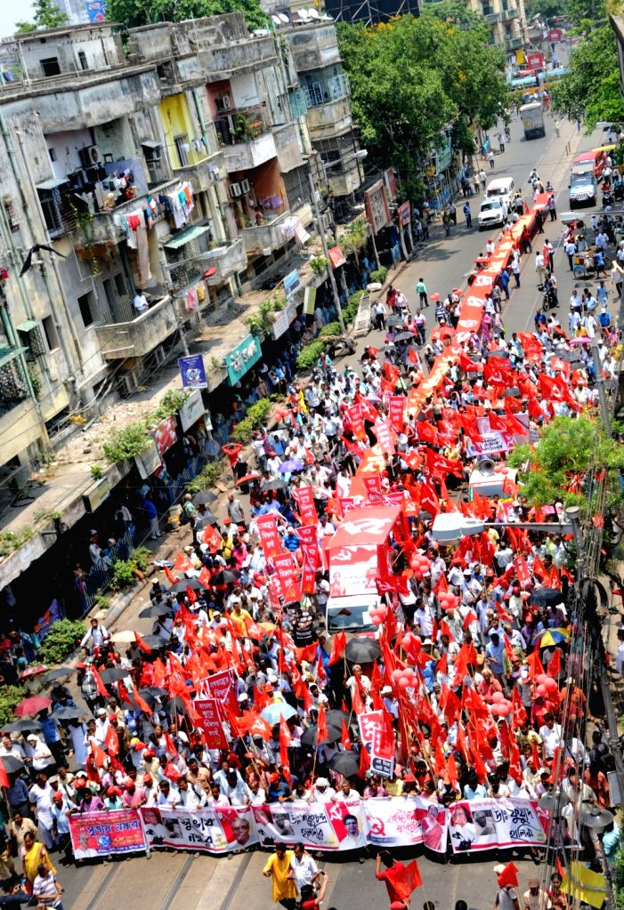 CPI-M workers participate in a roadshow by the party's Lok Sabha candidates from West Bengal - Fuad Halim (Diamon Harbour), Subhas Naskar (Jaynagar), Bikas Ranjan Bhattacharya (Jadavpur),  ... - Nandini Mukherjee