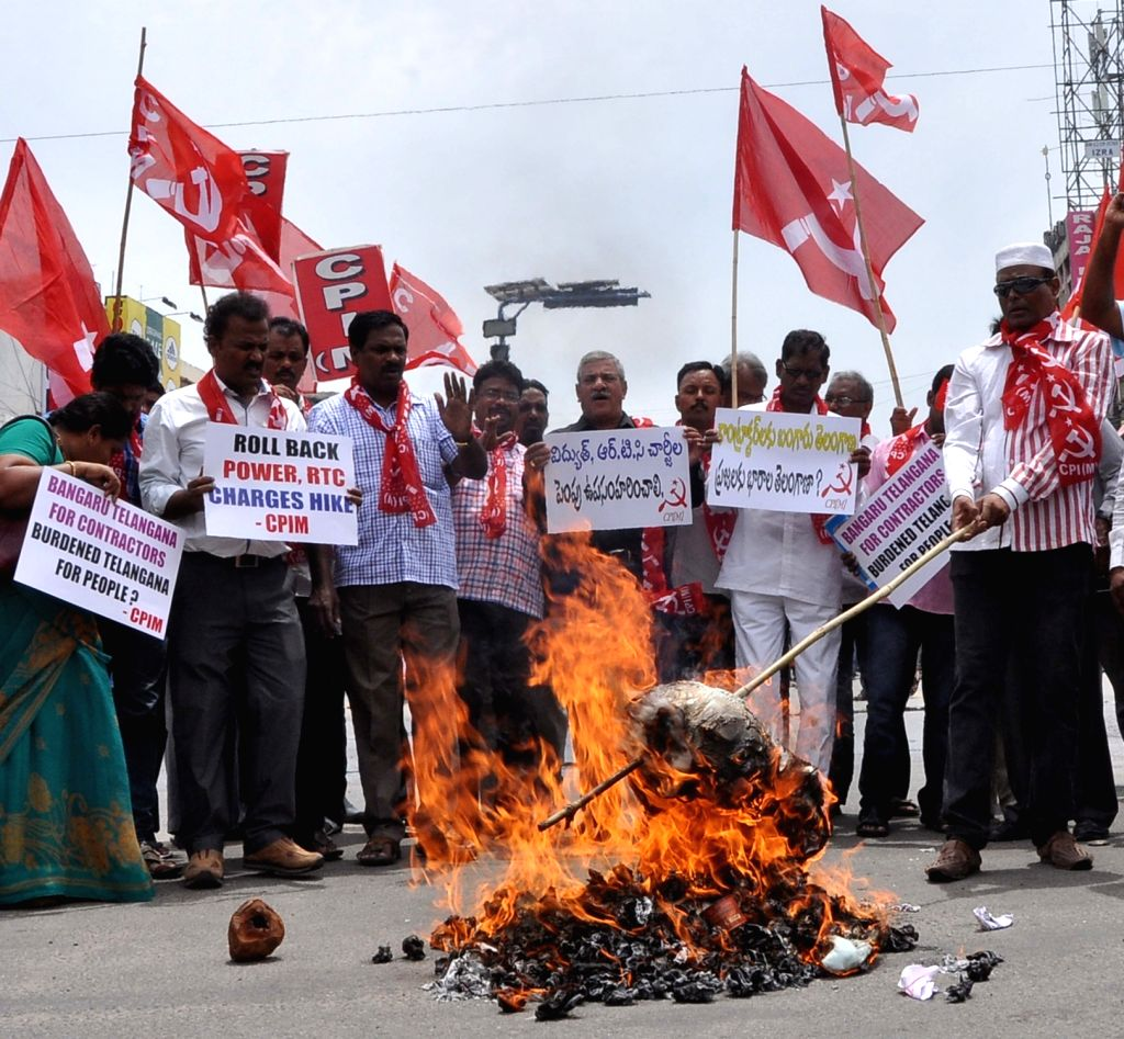 CPI-M workers stage a demonstration against hike in power tariff in Hyderabad, on June 24, 2016.