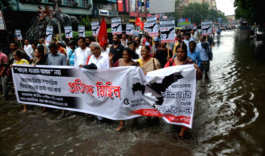 CPI-M workers stage a demonstration against NRC in Assam, in Kolkata on Aug 5, 2018.