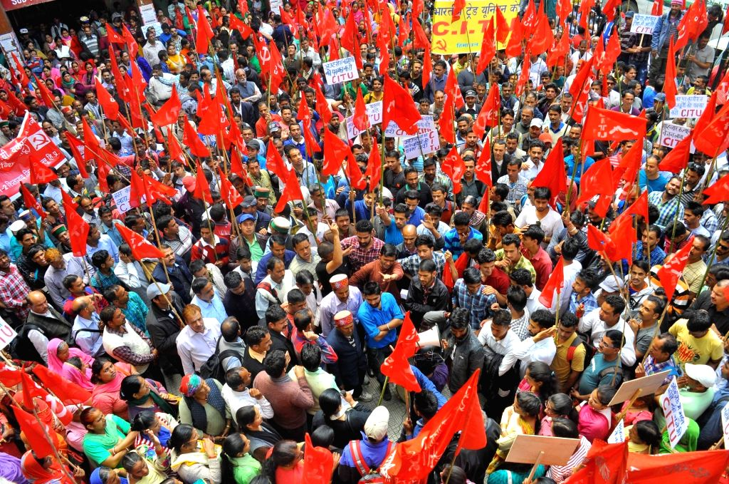 CPI-M workers stage a demonstration to press for their demands in Shimla on May 30, 2017.