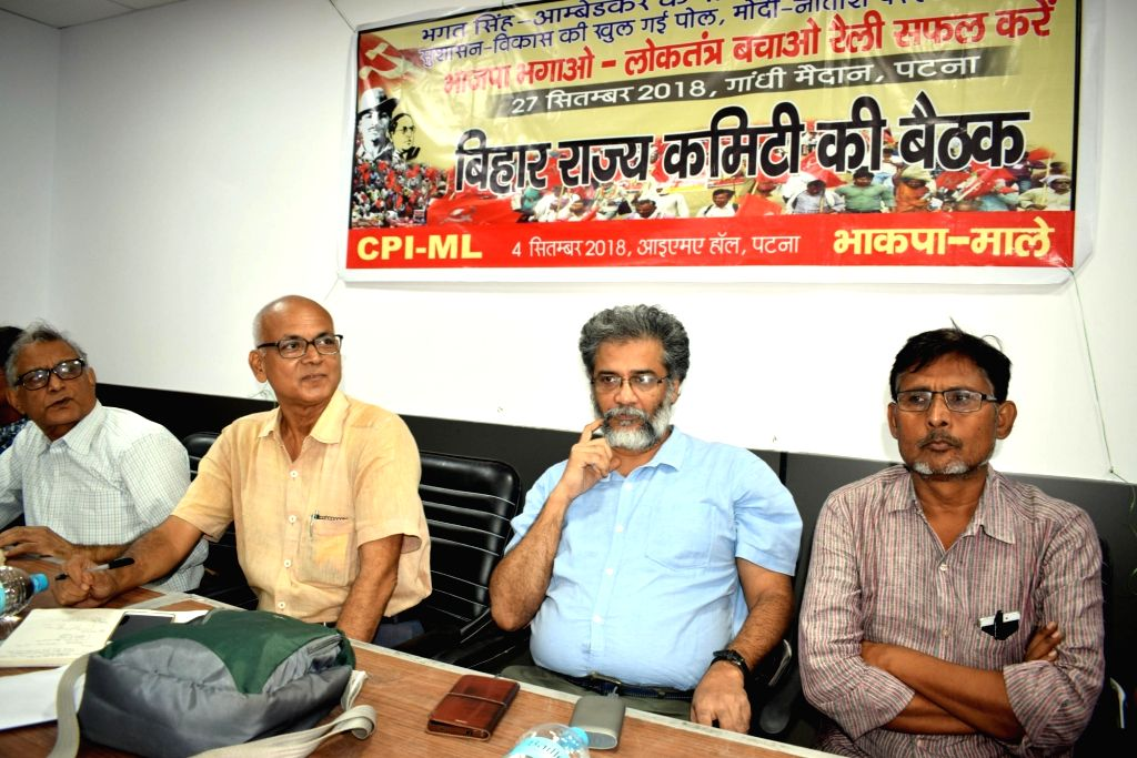 CPI-ML General Secretary Dipankar Bhattacharya and other party leaders during a party programme, in Patna on Sept 4, 2018.