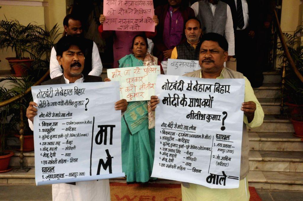 CPI(ML) leaders stage a demonstration against demonetisation at Bihar Assembly in Patna on Nov 29, 2016.