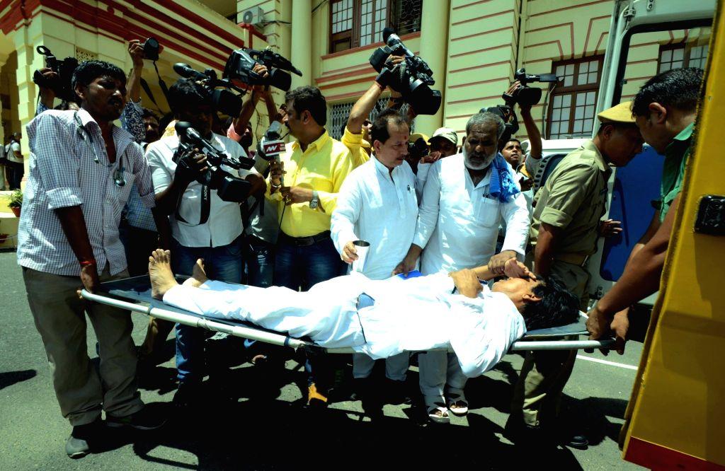 CPI-ML legislator Mahbub Alam who got injured while demonstrating in Bihar Assembly being taken away for treatment in Patna on Aug 4, 2016.
