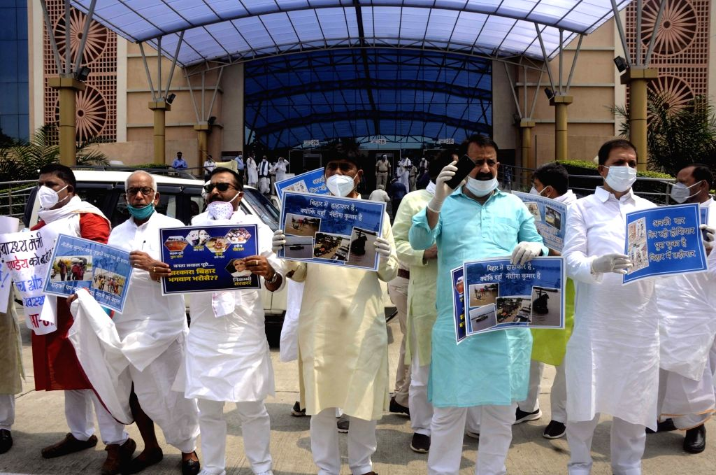 CPI-ML legislators stage a demonstration against the Nitish Kumar-led Bihar Government over rising COVID-19 cases and flood situation in the state, on the first day of the Monsoon Session of ... - Nitish Kumar