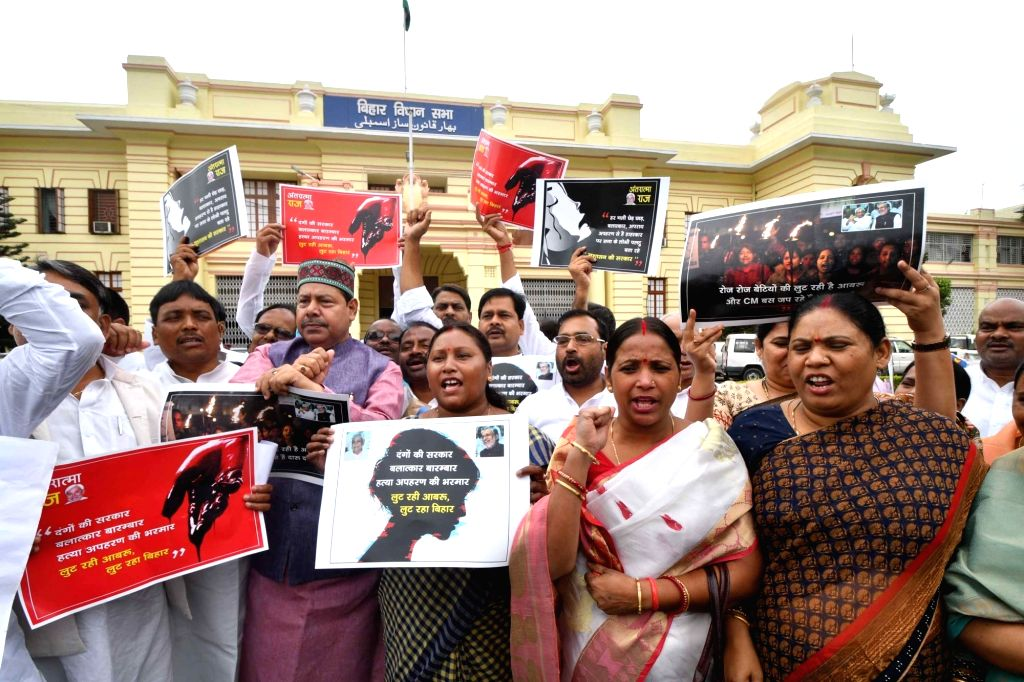 CPI-ML legislators stage a demonstration against the alleged rape-murders of inmates of a girls' home in Muzaffarpur; at Bihar Legislative Assembly in Patna on July 24, 2018.