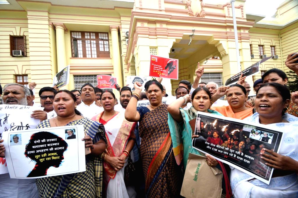 CPI-ML legislators stage a demonstration against the alleged rape-murders of inmates of a girls' home in Muzaffarpur; at Bihar Legislative Assembly in Patna on July 24, 2018.