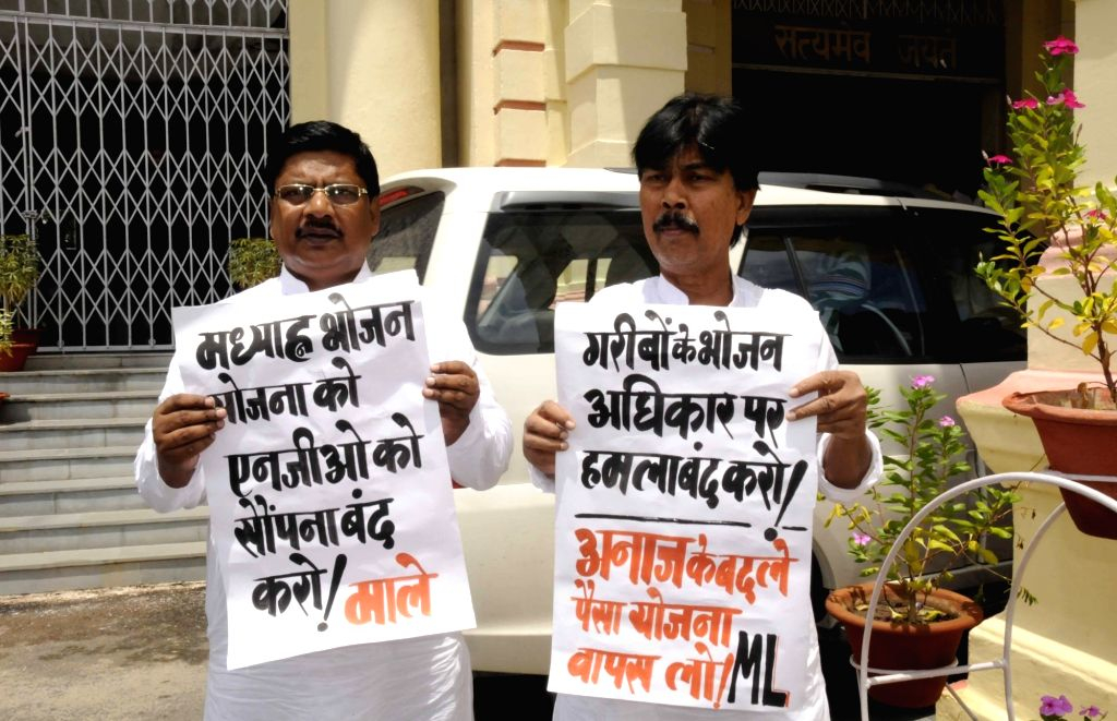 CPI-ML legislators stage a demonstration at Bihar Assembly to press for their demands in Patna on Aug 2, 2016.
