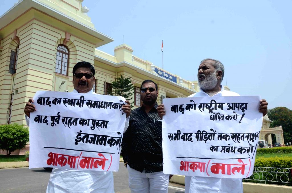CPI-ML legislators stage a demonstration over the flood situation in Bihar, at the state assembly in Patna on July 19, 2019.