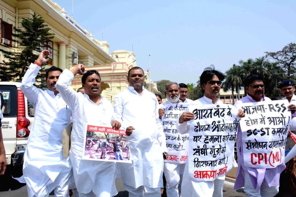 CPI-ML legislators stage a demonstration to press for their demands at Bihar Assembly in Patna, on April 3, 2018.