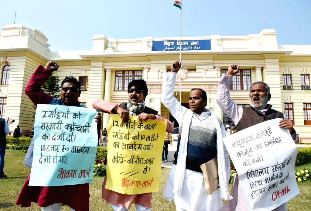 CPI-ML legislators stage a demonstration to press for their demands at Bihar Assembly in Patna on Feb 12, 2019.