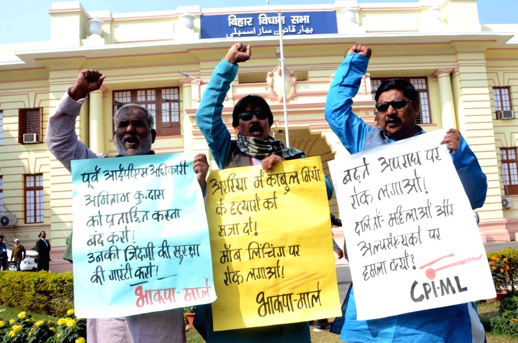 CPI-ML legislators stage a demonstration to press for their demands at Bihar Assembly in Patna on Feb 13, 2019.