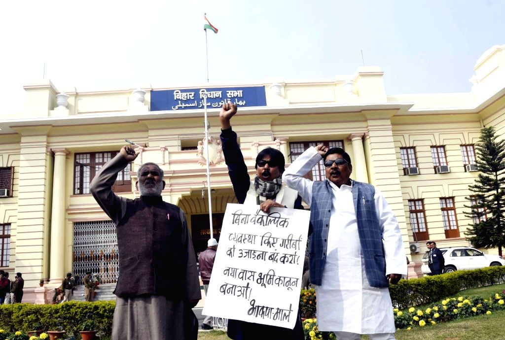 CPI-ML legislators stage a demonstration to press for their demands at Bihar Assembly in Patna on Feb 14, 2019.