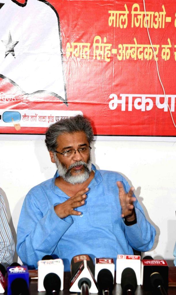 CPI-ML National General Secretary Dipankar Bhattacharya addresses a press conference, in Patna, on April 26, 2019.