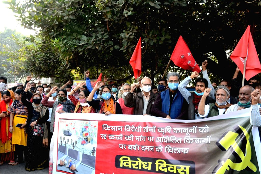 CPI-ML workers led by its General Secretary Dipankar Bhattacharya, protest against the Central Government's Farm Laws, expressing solidarity with the Farmers' movement, in Patna on Nov 30, ...