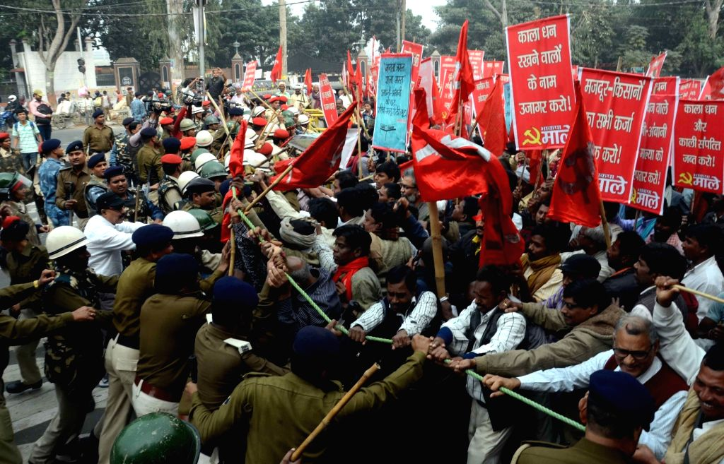CPI(ML) workers led by party leader Dipankar Bhattacharya participate in a march against demonetisation in Patna on Nov 28, 2016.