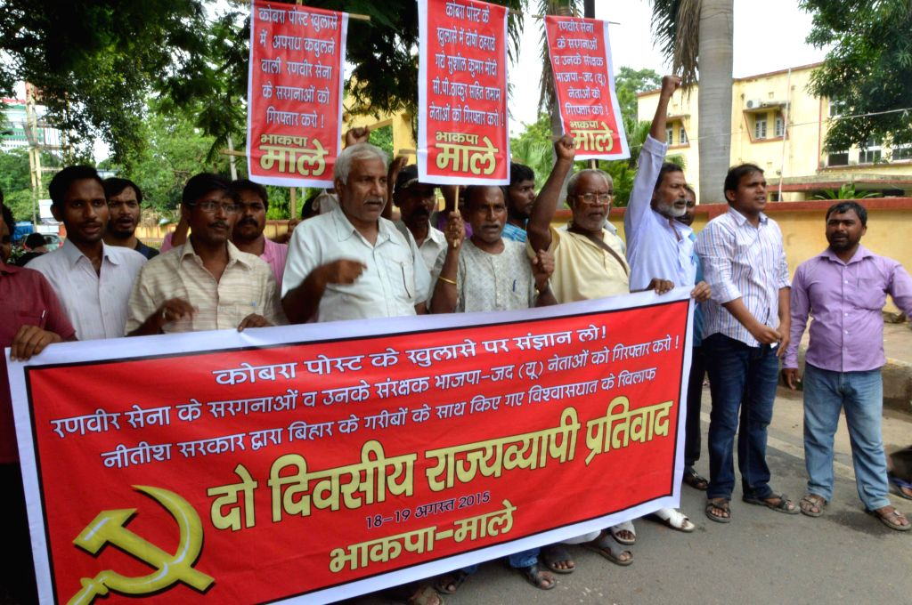 CPI-ML workers stage a demonstration against Bihar Chief Minister Nitish Kumar in Patna on Aug 18, 2015. - Nitish Kumar