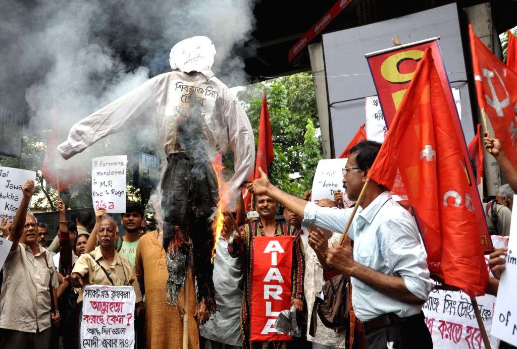 CPI(ML) workers stage a demonstration against killing of five farmers in Madhya Pradesh's Mandsaur district; in Kolkata on June 9, 2017.