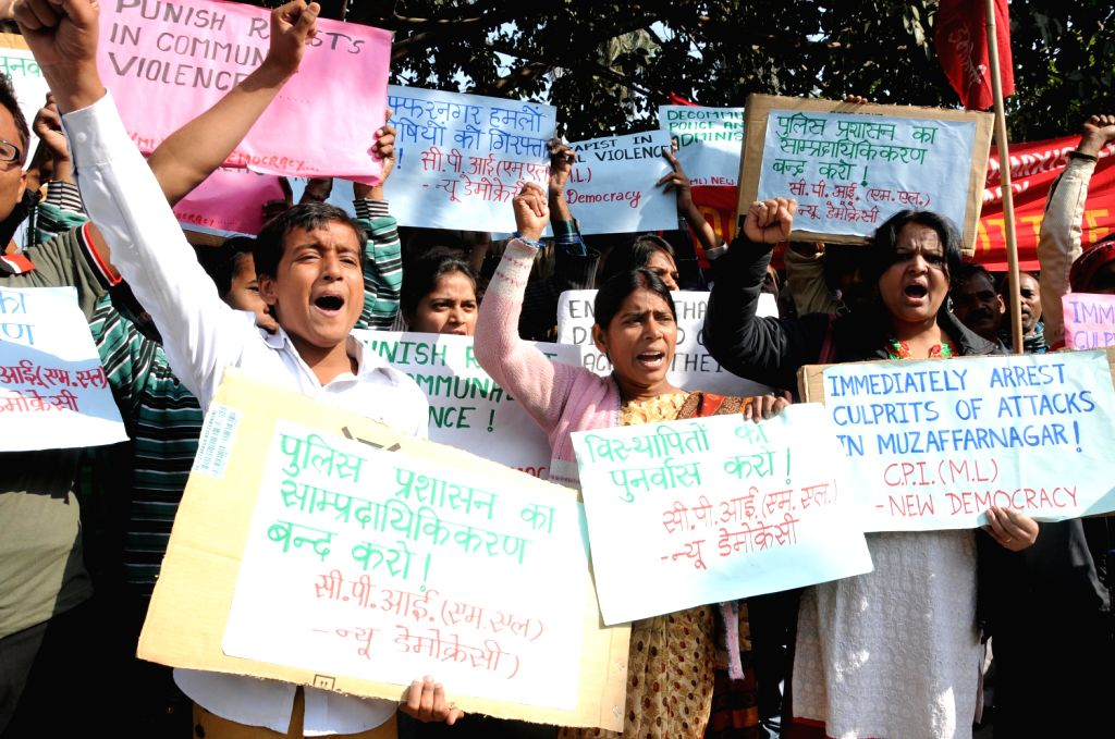 CPI- ML workers stage a demonstration to protest against Muzafarnagar gang-rape at Jantar Mantar  in New Delhi on Dec.6, 2013.