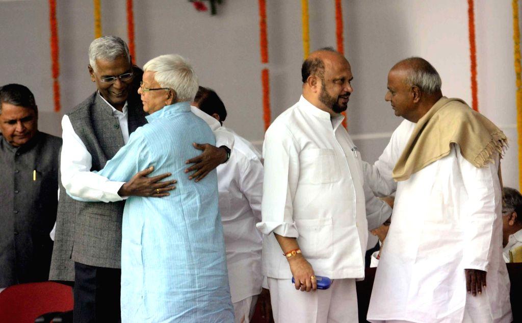 CPI national secretary D Raja, Asom Gana Parishad leader Prafulla Kumar Mahanta, Former Prime Minister HD Deve Gowda and RJD chief Lalu Prasad Yadav during the swearing-in ceremony of the new ... - Prafulla Kumar Mahanta and Lalu Prasad Yadav