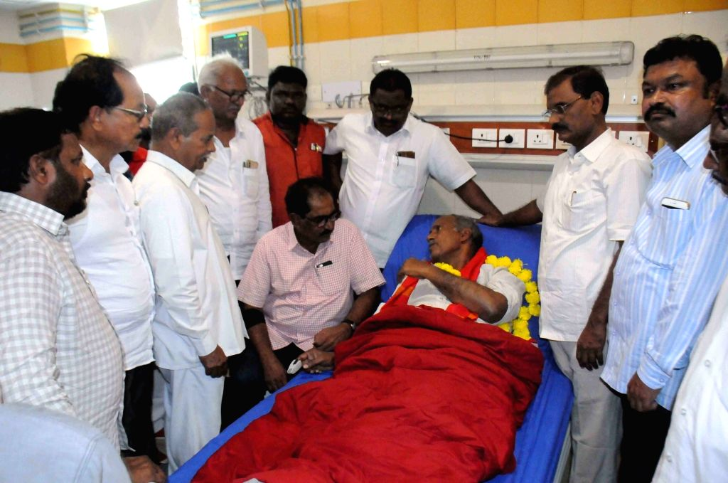 CPI workers and trade union leaders meet party leader Kunamaneni Sambasiva Rao who was on an indefinite hunger strike in support of the striking TSRTC employees, after he was admitted at ... - Kunamaneni Sambasiva Rao