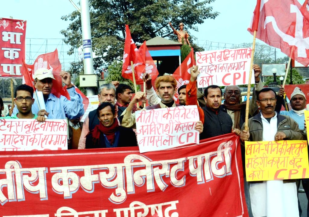 CPI workers stage demonstration to press for their demands in Patna on Jan 15, 2016.
