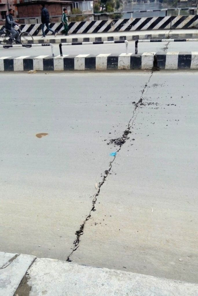 Cracks appear in a Baramulla road after an earthquake jolted the city on Oct 26, 2015.