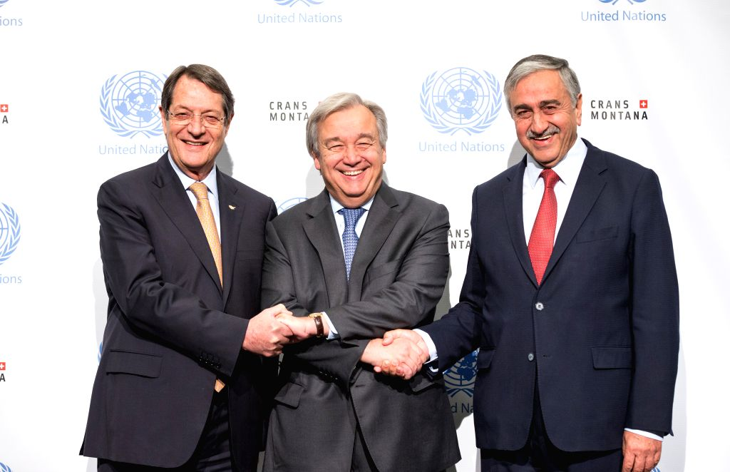 CRANS-Cypriot President Nicos Anastasiades (L), Turkish Cypriot leader Mustafa Akinci (R) and UN Secretary-General Antonio Guterres pose for a photo during the new ...