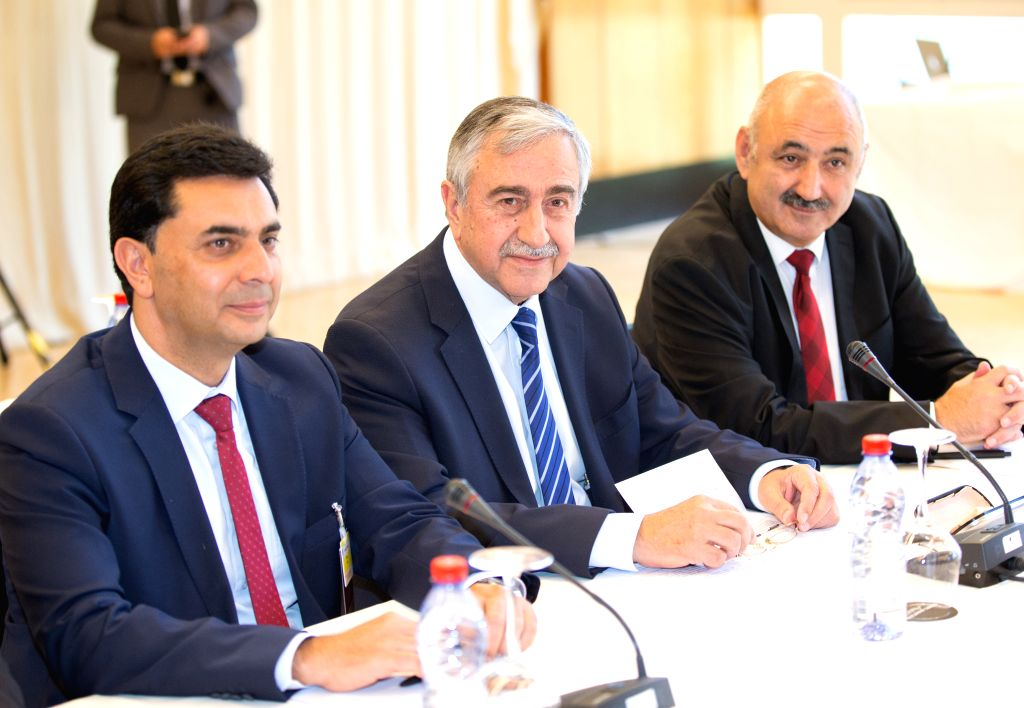 CRANS-MONTANA (SWITZERLAND), July 6, 2017 Turkish Cypriot leader Mustafa Akinci (C) takes part in a new round of the Conference on Cyprus under the auspices of the United Nations in ...
