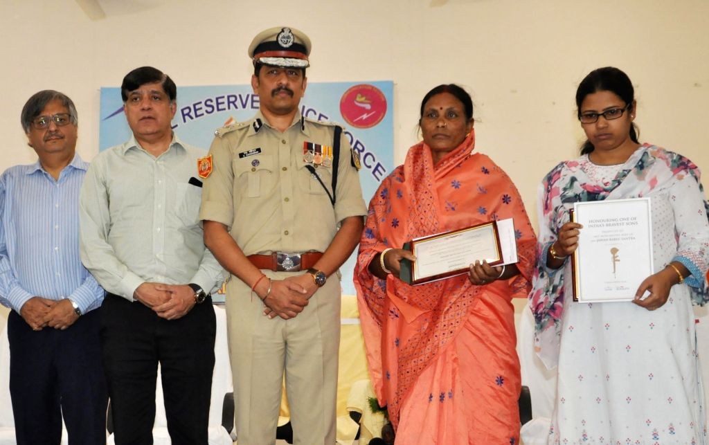 CREDAI Bengal President Nandu Belani, CRPF Inspector General (Operations) S. Raveendran and wives of slain CRPF troopers from West Bengal, Sudip Biswas and Bablu Santra who lost their lives ...