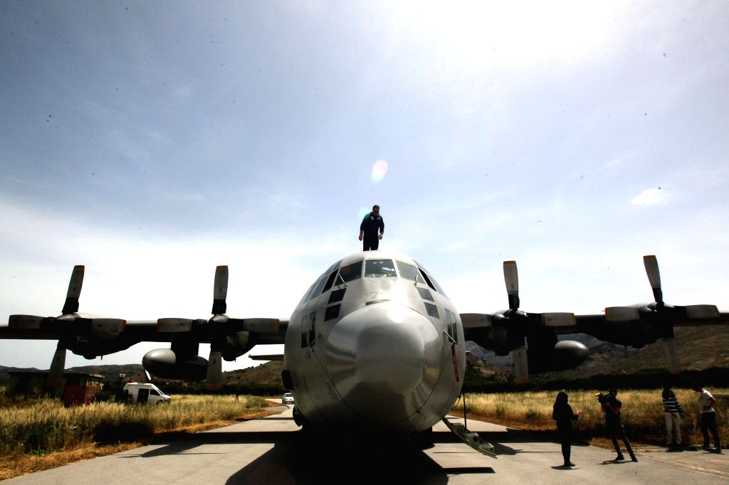 CRETE ISLAND, May 20, 2016 - A Greek Air Force officer inspects a C-130 aircraft at the Greek military base of Kastelli on Crete island on May 20, 2016. Greek military aircrafts have been ...