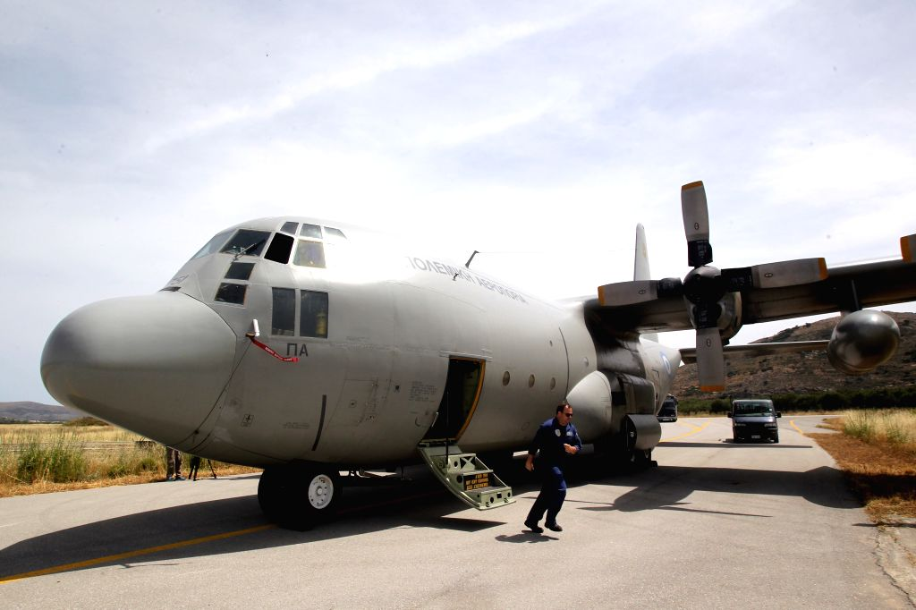 CRETE ISLAND, May 20, 2016 - A Greek Air Force officer inspects a C-130 aircraft at the Greek military base of Kastelli on Crete island on May 20, 2016. Greek military aircraft have been ...