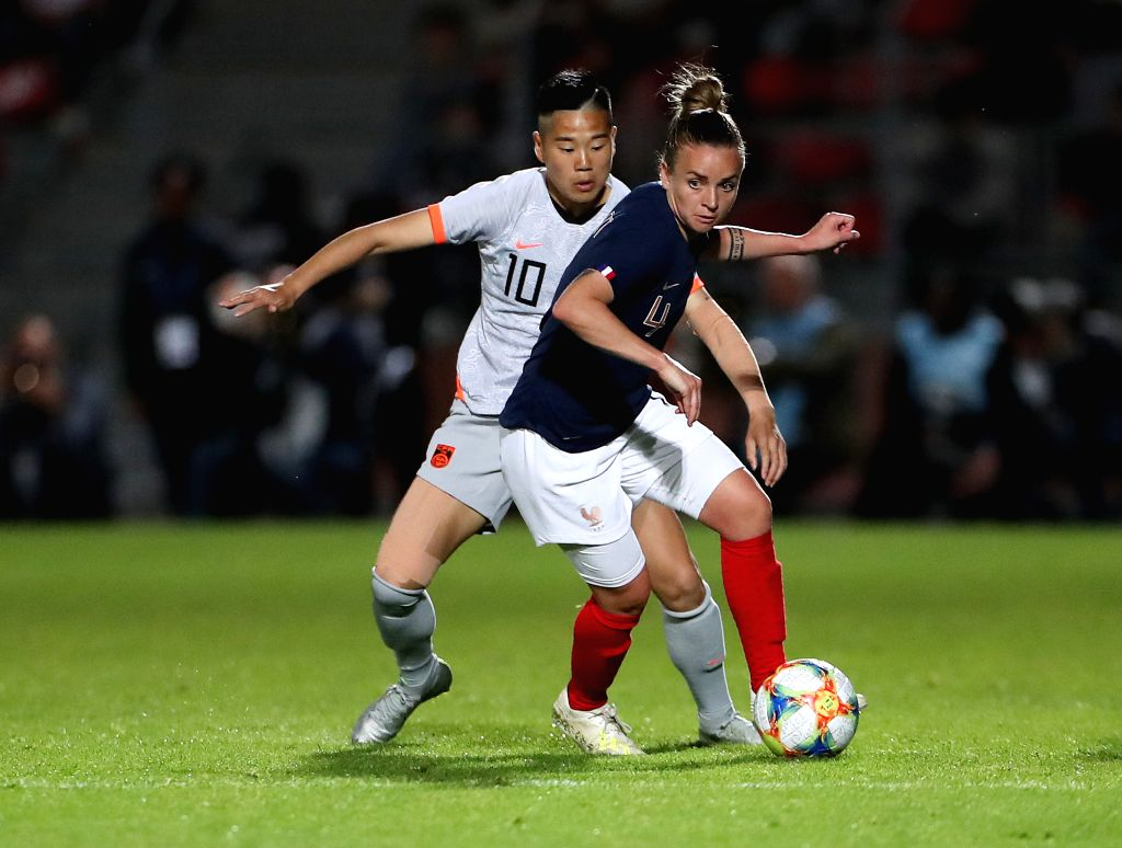 CRETEIL, June 1, 2019 - Li Ying (L) of China vies with Marion Torrent of France during a friendly soccer match between France and China in Creteil, France, May 31, 2019. France won 2-1.