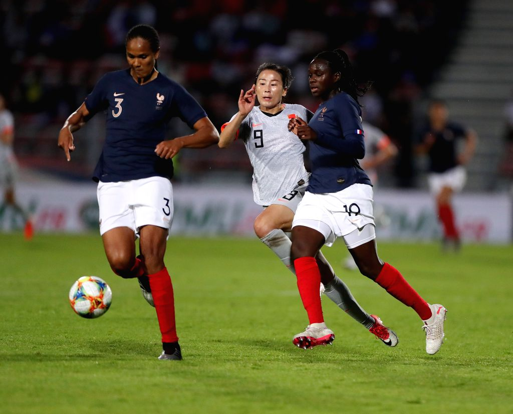 CRETEIL, June 1, 2019 - Yang Li (C) of China vies with Wendie Renard (L) of France during a friendly soccer match between France and China in Creteil, France, May 31, 2019. France won 2-1.