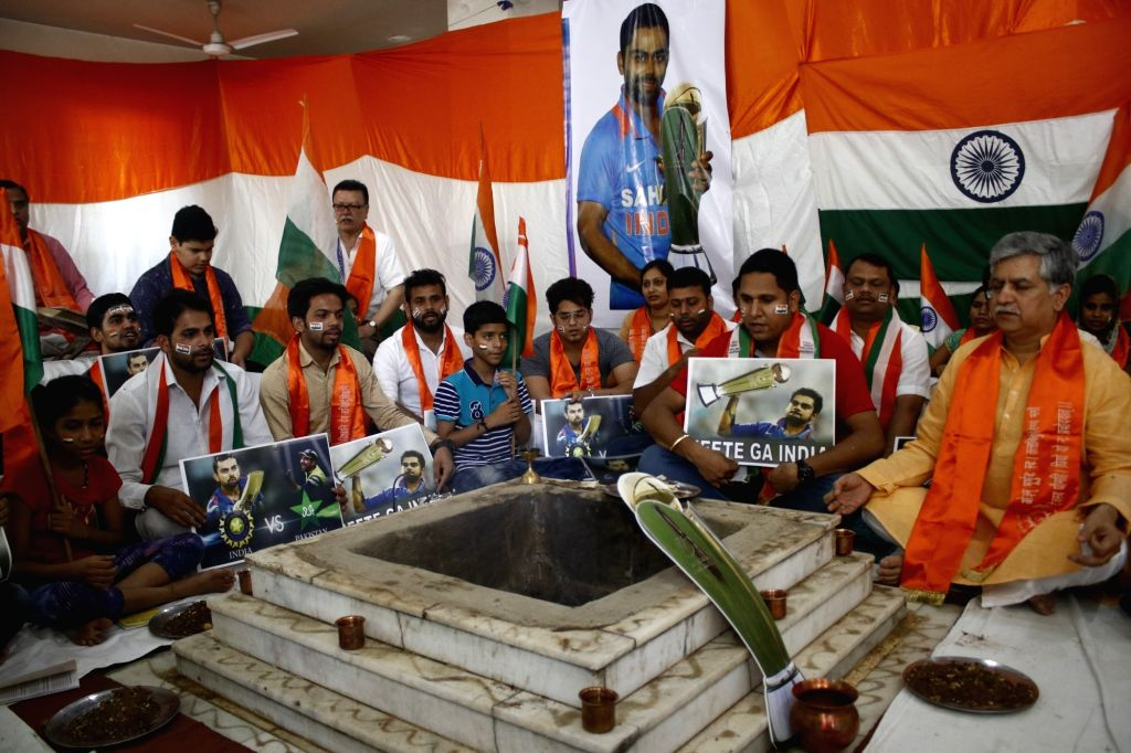 Cricket fans organise havan for victory of India during an ICC Champions Trophy match against Pakistan in New Delhi on June 4, 2017. The mach is being played at Edgbaston, Birmingham in UK.