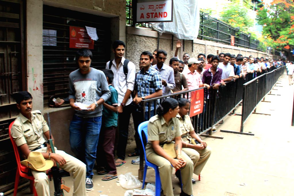 Cricket fans queue-up to buy IPL tickets at the Chinnaswamy Stadium in Bangalore on May 6, 2014.