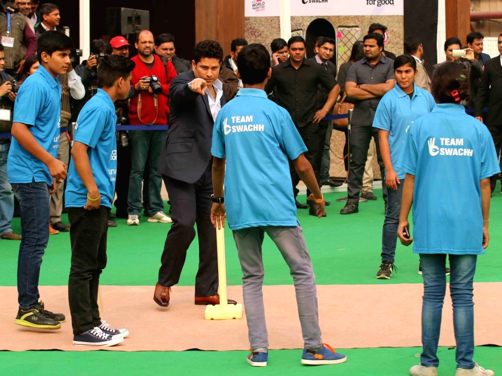 Cricket legend Sachin Tendulkar with budding cricketers at the launch of ICC Cricket for Good & Team Swachh campaign in New Delhi, on Jan 18, 2016. - Sachin Tendulkar