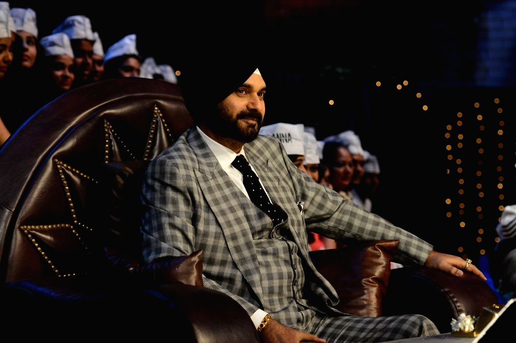 Cricket player Navjot Singh Sidhu during the promotion of film Anna: Kisan Baburao Hazare on the sets of The Kapil Sharma Show in Mumbai on Sept. 23, 2016. - Navjot Singh Sidhu