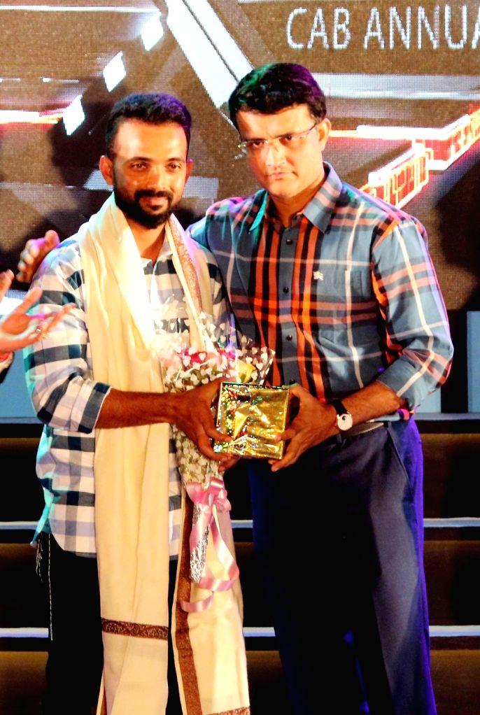 Cricketer Ajinkya Rahane with former cricketer Jhulan Goswami during CAB's Annual Award Ceremony 2018-2019 in Kolkata on Aug 3, 2019. - Jhulan Goswami