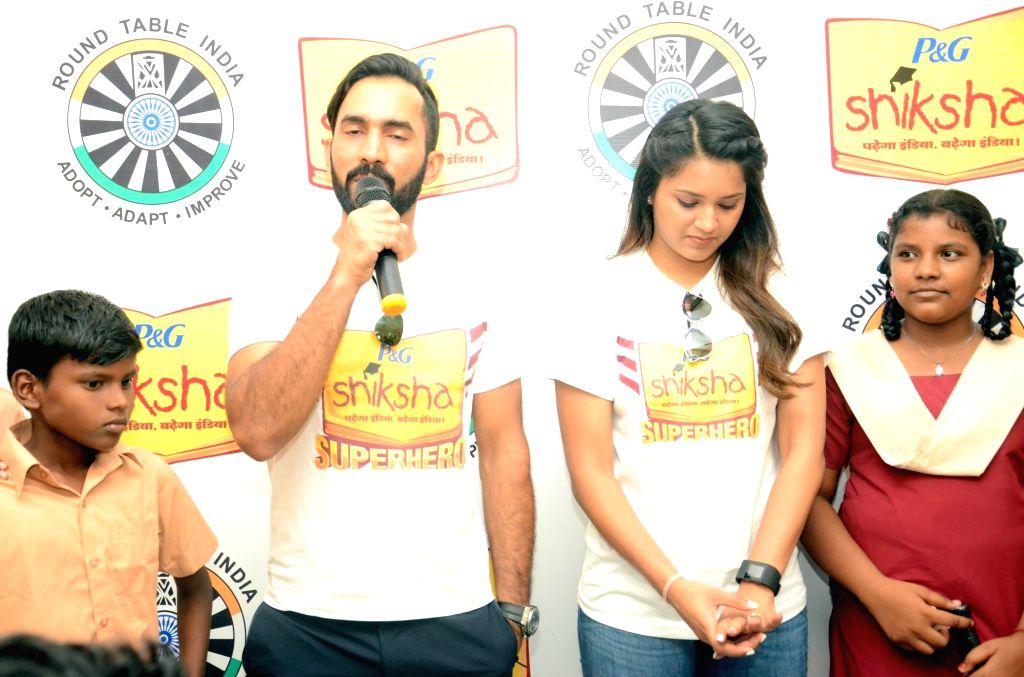 Cricketer Dinesh Karthik and Dipika Pallikal during a P&G Shiksha programme in Chennai on June 16, 2016.