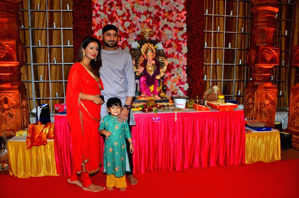 Cricketer Harbhajan Singh with his wife Geeta Basra and daughter Hinaya Heer Plaha during Ganesh Chaturthi celebrations, in Mumbai on Sep 3, 2019. - Harbhajan Singh