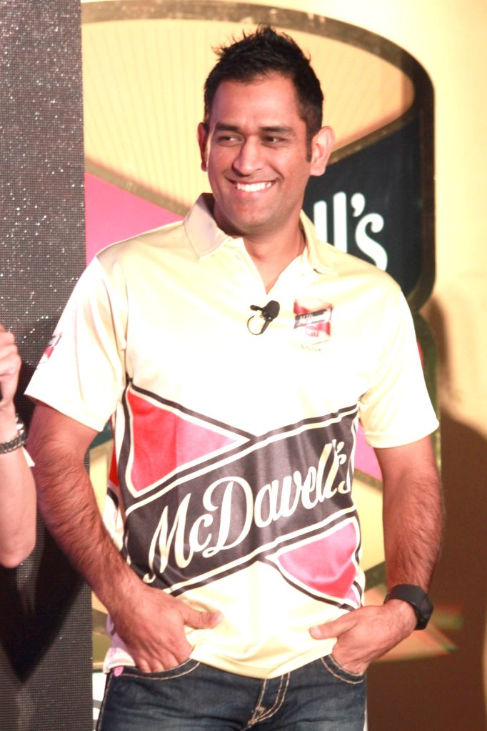 Cricketer Mahendra Singh Dhoni during a promotional programme in New Delhi, on Nov 2, 2015. - Mahendra Singh Dhoni