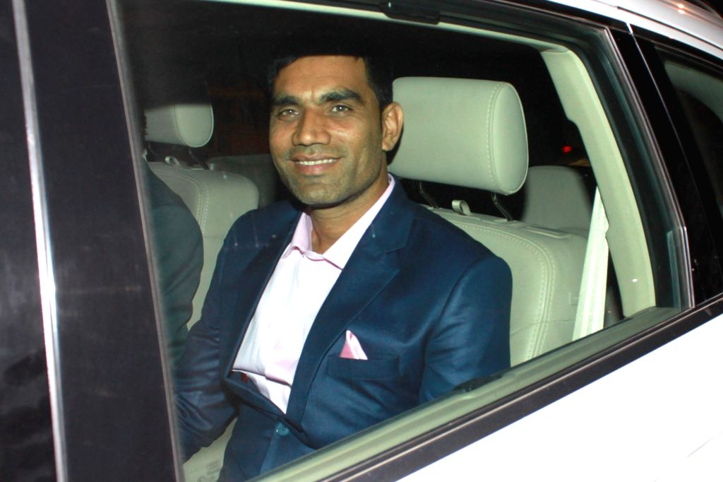Cricketer Munaf Patel arrives to attend the wedding reception of cricketer Harbhajan Singh and actress Geeta Basra in New Delhi, on Nov 1, 2015. - Munaf Patel