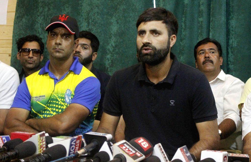 Cricketer Parvez Rasool addresses a press conference in Srinagar on July 16, 2019.