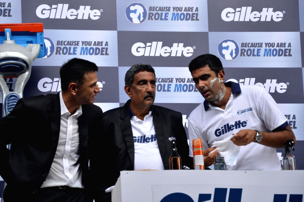 Cricketer Rahul Dravid and R Ashwin with his father N Ravichandran during an event organized to celebrate a nationwide campaign `Because You Are A Role Model` by Gillette in Mumbai on June 17th, ... - Rahul Dravid