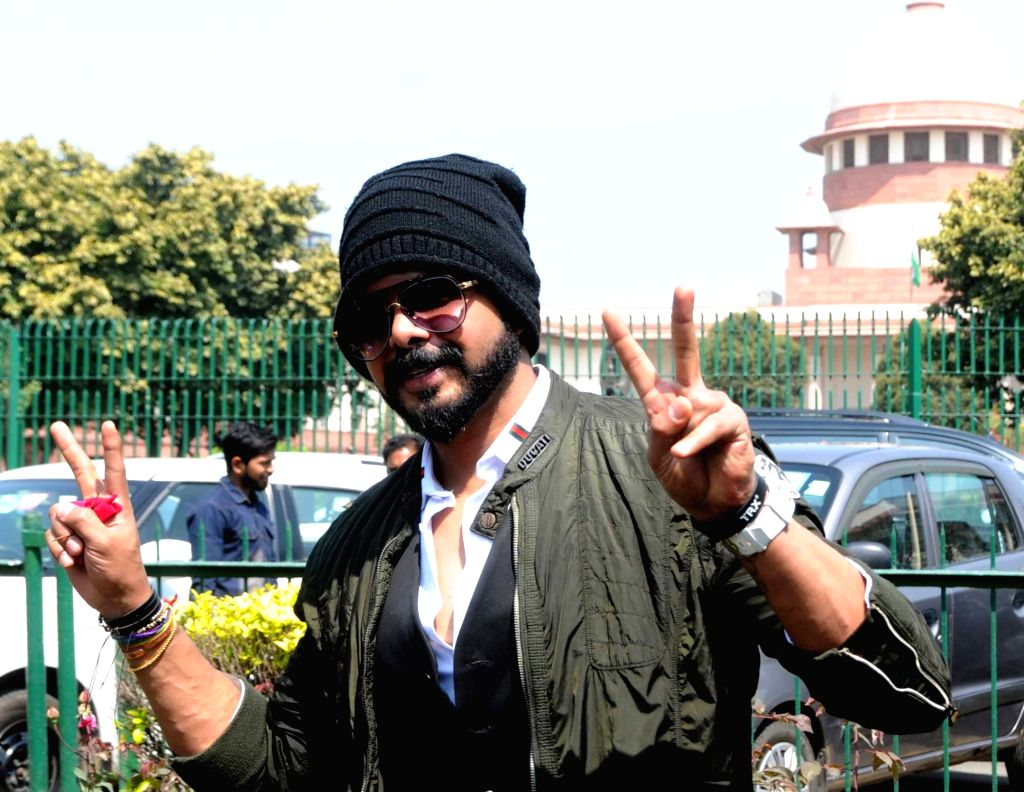 Cricketer S. Sreesanth shows victory sign after the Supreme Court cancelled life ban on him and asked the Board of Control for Cricket in India (BCCI) to reconsider his punishment, in New ...