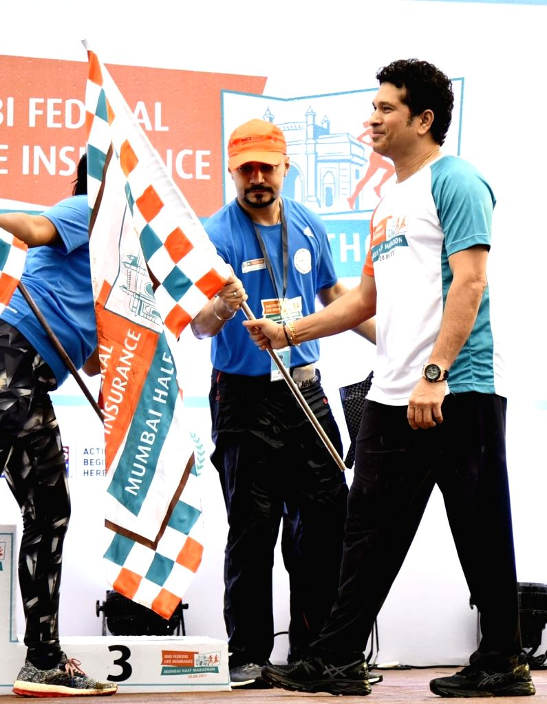 Cricketer Sachin Tendulkar at the flagging-off ceremony of the IDBI Federal second edition of Mumbai Half Marathon held at Bandra Kurla Complex in Mumbai on Aug 20, 2017. - Sachin Tendulkar