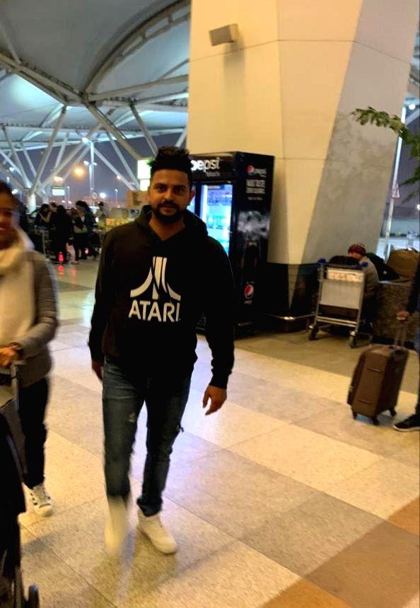 Cricketer Suresh Raina seen at Indira Gandhi International Airport in New Delhi, on Jan 24, 2019.