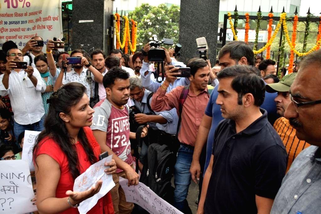 Cricketer turned politician Gautam Gambhir meets protesting teachers in New Delhi on Oct 16, 2019.