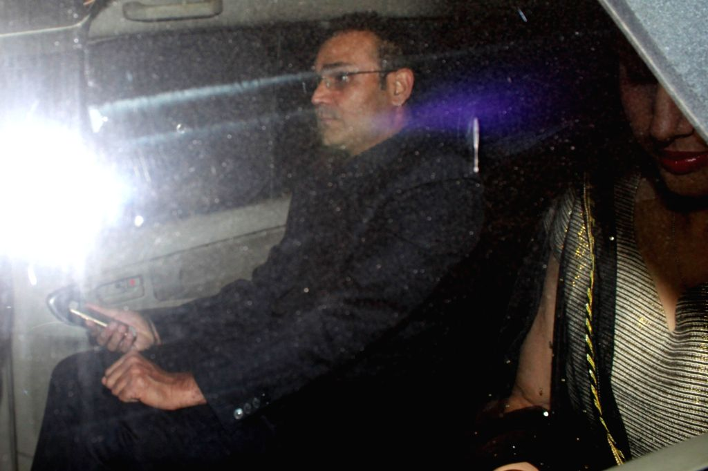 Cricketer Virendra Sehwag arrives to attend the wedding reception of cricketer Harbhajan Singh and actress Geeta Basra in New Delhi, on Nov 1, 2015.